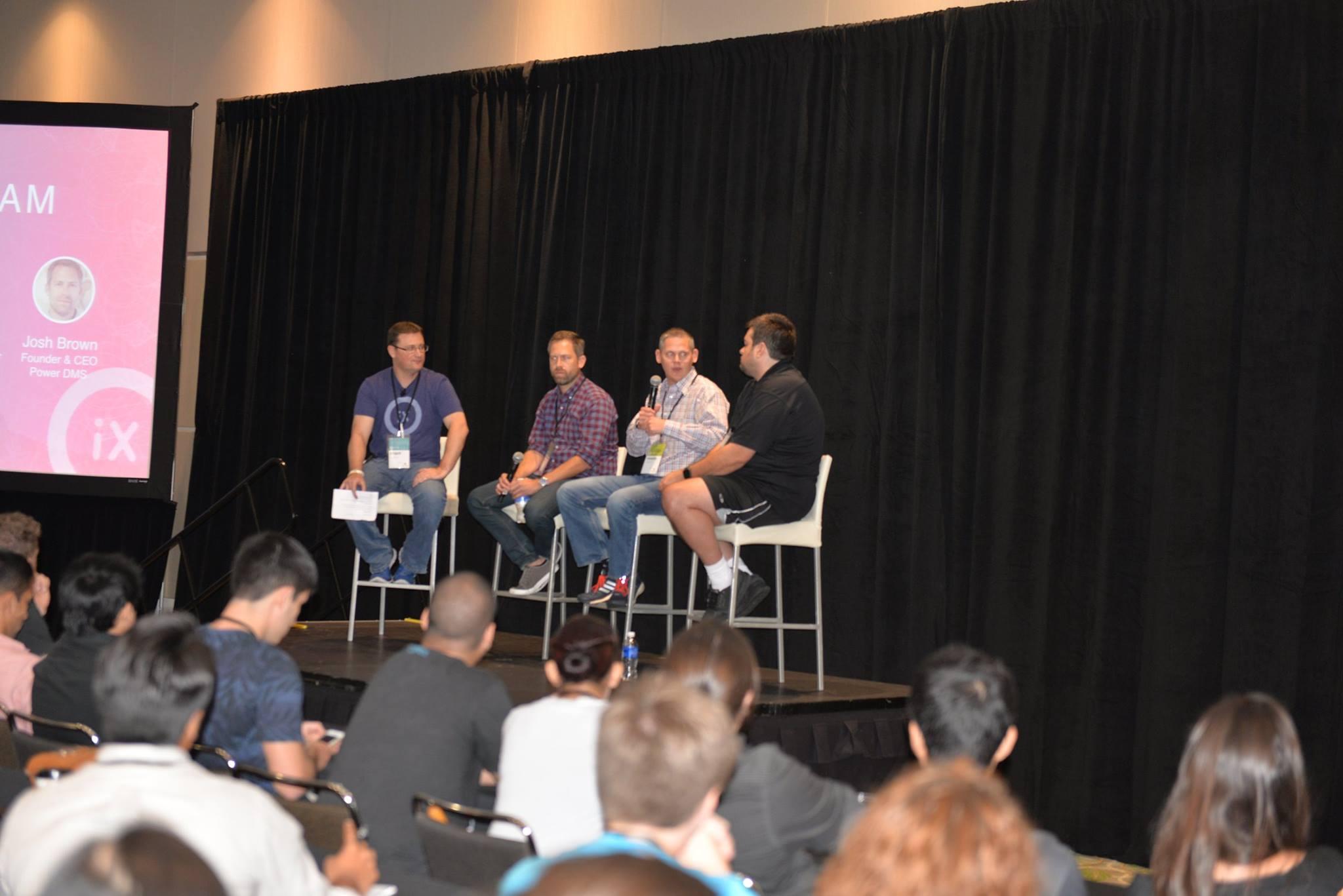 David C. Glass moderating a panel at OrlandoiX 2015
