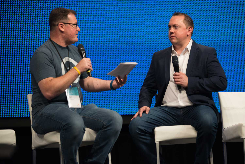 David Glass moderating a fireside chat with Nathan Pettyjohn